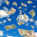 Photo of money flying in the sky